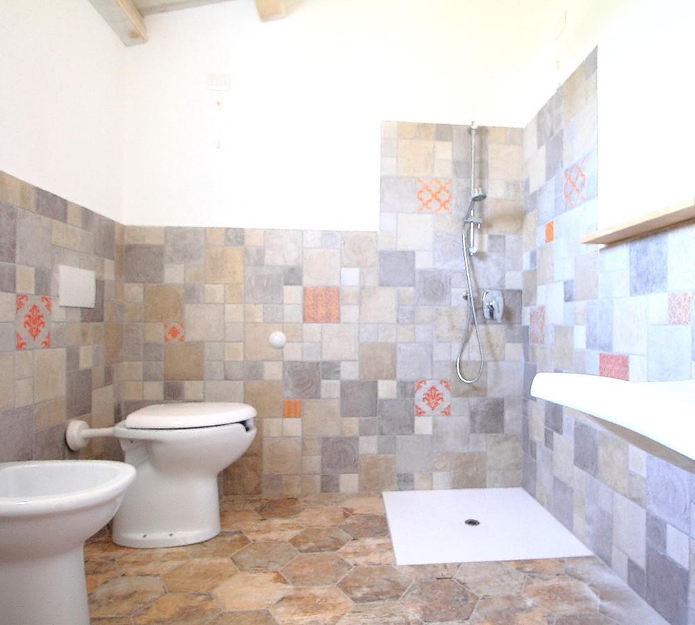 camera-con-bagno-e-veranda